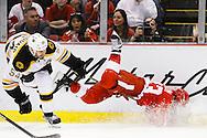 Apr 2, 2015; Detroit, MI, USA; Detroit Red Wings center Darren Helm (43) is up ended by Boston Bruins defenseman Adam McQuaid (54) in the third period at Joe Louis Arena. Boston won 3-2. Mandatory Credit: Rick Osentoski-USA TODAY Sports