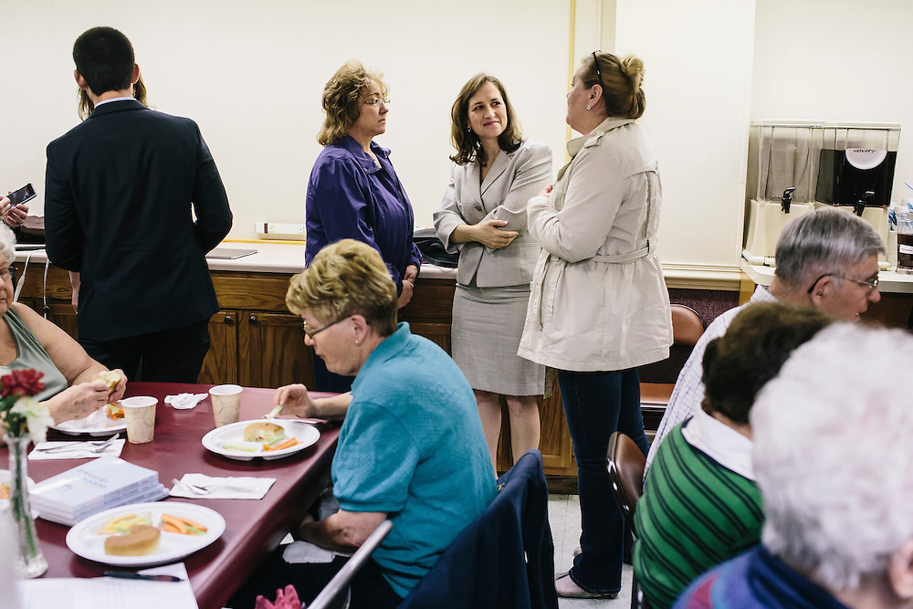 West Virginia Secretary of State Natalie Tennant talks with guests Cathy Evans, left, and Cathy Simon, right, at the Romney First United Methodist Church in Romney, W.V. on Wednesday, April 16, 2014. Tennant is running for the US Senate seat in West Virginia against popular Republican Rep. Shelley Moore Capito.
