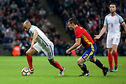 England attacker Andros Townsend (17) dribbling away from Spain defender Cezar Azpilicueta (02) during the Friendly match between England and Spain at Wembley Stadium, London, England on 15 November 2016. Photo by Matthew Redman.
