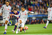 Liverpool defender Virgil van Dijk (4) and Liverpool midfielder Fabinho (3) try to stop Barcelona forward Lionel Messi (10) during the Champions League semi-final leg 1 of 2 match between Barcelona and Liverpool at Camp Nou, Barcelona, Spain on 1 May 2019.