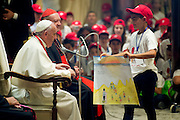"""Vatican City may 28th 2016, pope meets the """" Children's train """". In the picture pope Francis with a child that give to him a draw illustrating immigrants in Mediterranea sea"""