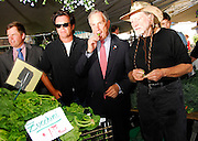 NEW YORK - JUNE 11: John Mellencamp, NYC Mayor Michael Bloomberg, and Willie Nelson pose in a stall in the Farmer's Market before the press conference announcing plans for Farm Aid in Union Square Park on June 11, 2007 in New York City.