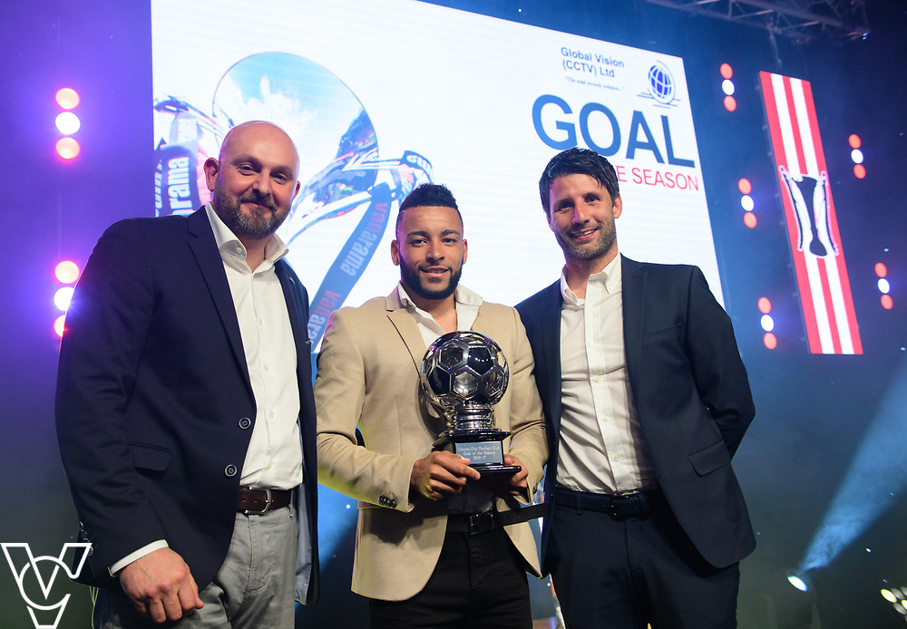 Lincoln City Football Club's 2016/17 End of Season Awards night - Championship Seasons Awards Dinner - held at the Lincolnshire Showground.<br /> <br /> GOAL OF THE SEASON:  Rob McGill, from Global Vision, left, and Lincoln City manager Danny Cowley, right, present the goal of the season award, sponsored by Global Vision, to Nathan Arnold.<br /> <br /> Picture: Chris Vaughan Photography for Lincoln City Football Club<br /> Date: May 20, 2017