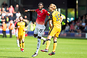 Salford City forward Mani Dieseruvwe and Port Vale defender Nathan Smith in areal challenge during the EFL Sky Bet League 2 match between Salford City and Port Vale at Moor Lane, Salford, United Kingdom on 17 August 2019.