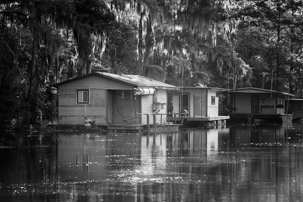 Fishing camps on a bayou leading to  Lake Boeuf.