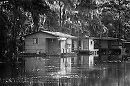 Fishing camps on a bayou leading to  Lake Boeuf.