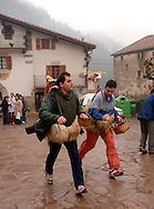 People collect food donations for the performers during the carnival of Zubieta on January, 31st 2006 in the Basque Country.  Joaldun groups take part in the carnival at the villages of Ituren and Zubieta carrying sheep furs and big cowbells on their backs to wake up the earth, looking for a good new year, a good harvest and to keep away the bad spirits... Bostok Photo: Ander Gillenea