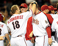 Sep. 27 2011; Phoenix, AZ, USA; Arizona Diamondbacks infielder Willie Bloomquist (18) and pitcher Micah Owings (15) celebrate on the field after playing against the Los Angeles Dodgers at Chase Field. The Diamondbacks defeated the Dodgers 7-6 in extra innings.  Mandatory Credit: Jennifer Stewart-US PRESSWIRE.