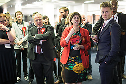 © Licensed to London News Pictures . 08/06/2017 . Manchester , UK . MIKE KANE and LUCY POWELL with fellow Labour Party supporters watch results come in on TV at the Manchester Central Convention Centre where the count for the constituencies of Blackley and Broughton, Manchester Central, Manchester Gorton, Manchester Withington and Wythenshawe and Sale East, in the General Election, is taking place . Photo credit : Joel Goodman/LNP