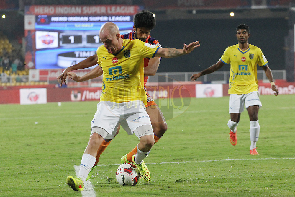 Iain Hume of Kerala Blasters FC fends off the attack during match 17 of the Hero Indian Super League between FC Pune City<br /> and Kerala Blasters FC held at the Shree Shiv Chhatrapati Sports Complex Stadium, Pune, India on the 30th October 2014.<br /> <br /> Photo by:  Ron Gaunt/ ISL/ SPORTZPICS