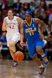 January 20, 2011; Stanford, CA, USA;  UCLA Bruins guard/forward Atonye Nyingifa (11) dribbles past Stanford Cardinal forward/center Sarah Boothe (42) during the first half at Maples Pavilion.