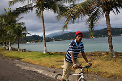 Daily life in Port Antonio, home of the Geejam, a luxury boutique hotel with a state of the art recording studio that has attracted famous musicians to make their albums.