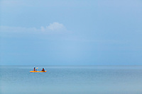 Two Thai young men in a kayak on the Gulf of Thailand, Ko Phangnan (Phangan), Thailand&#xA;<br />