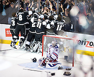 The Kings' celebrate Alec Martinez' game-winning goal on Rangers' goaltender Henrik Lundqvist to give the Kings a 3-2 victory to win the 2014 Stanley Cup at Staples Center Friday.
