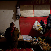 DONETSK, UKRAINE - OCTOBER 16, 2014: A local IDP stands beside her improvised bed at a Soviet era bomb shelter in Petrovskiy district, Donetsk. The daily routine of the almost hundred people living here for the past four months, can be tedious as the regular shellfire between DNR rebels and the Ukrainian National Guard is a constant threat that constrain them to stay underground most of the time. CREDIT: Paulo Nunes dos Santos