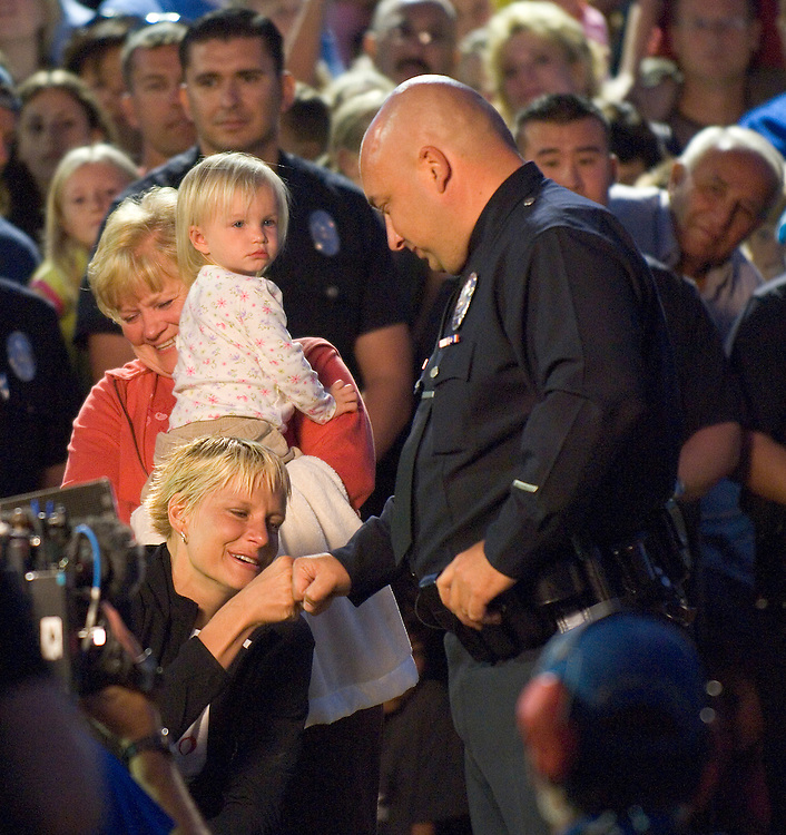 REDONDO BEACH, CA - 10/18/06  - LAPD Officer Kristina Ripatti reunites with her partner Officer Joe Meyer at the unveiling of her new home for Extreme Makeover: Home Edition, on October 18th, 2006 in Redondo Beach, CA. Officer Ripatti was severely injured when an ex-convict shot her after robbing a gas station in Los Angeles on June 3rd, 2006.