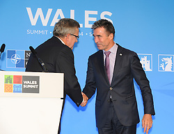 © London News Pictures. 05/09/2014. Newport, UK. <br /> Nato Secretary General Anders Fogh Ramussen and the President of Poland Bronislaw Komorowski shake hands at  at the NATO (North Atlantic Treaty Organisation ) summit at Celtic Manor Resort, Newport, South Wales. Photo credit: Jeff Thomas/LNP