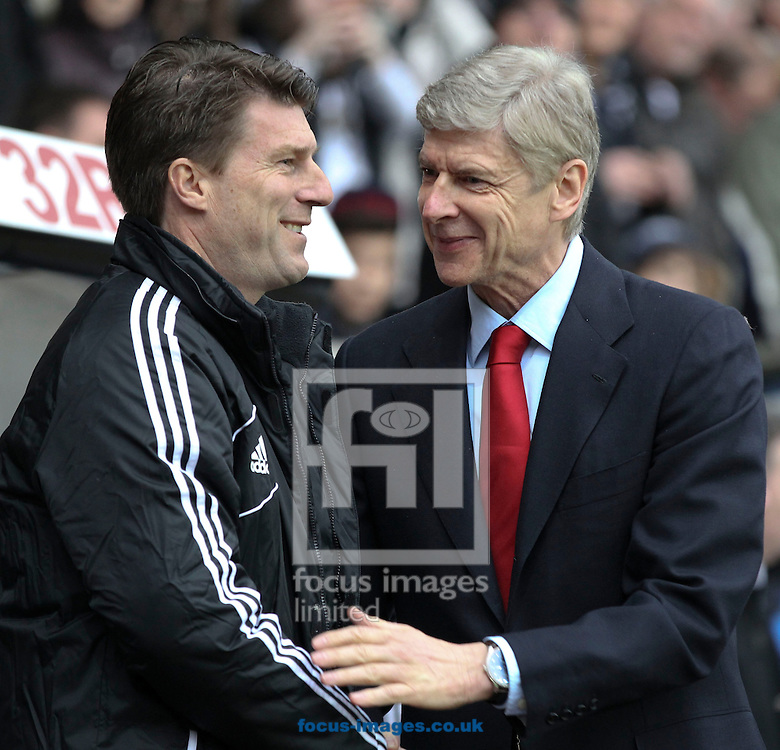 Picture by Mike  Griffiths/Focus Images Ltd +44 7766 223933.16/03/2013.Michael Laudrup of Swansea City and Arsene Wenger of Arsenal during the Barclays Premier League match at the Liberty Stadium, Swansea.