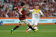 01.01.2014 Sydney, Australia. Wellingtons midfielder Louis Fenton in action during the Hyundai A League game between Western Sydney Wanderers FC and Wellington Phoenix FC from the Pirtek Stadium, Parramatta. Wellington won 3-1.