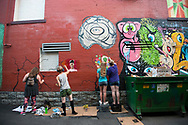Freak Alley Gallery seventh annual mural event in downtown Boise, Idaho on August 5, 2017. <br /> <br /> Freak Alley Gallery's week long event provided an &quot;art-in-motion&quot; experience as it welcomed the public to watch artists work on their murals.