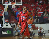 "Ole Miss guard Dundrecous Nelson (5) dribbles at the C.M. ""Tad"" Smith Coliseum in Oxford, Miss. on Tuesday, February 1, 2011. Ole Miss won 71-69."