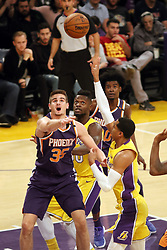 November 17, 2017 - Los Angeles, California, U.S - Lakers Jordan Clarkson goes up with this shot under  duress from Suns defender Dragan Bender during the  contest as the host Los Angeles Lakers fall to the visiting  Phoenix Suns 122-113 on Friday, November 17, 2017 at the  Staples Center in Los Angeles, California. (Credit Image: © Prensa Internacional via ZUMA Wire)