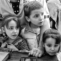 Egypt / Syrian refugees / Syrian refugees Zohoor Farahat, 6-years-old, Yamen Farahat, 8-years-old, and Lojain Farahat, 3-years-old, register for protection and other social services with their parents at UNHCR offices in the Zamalek neighborhood in Cairo, Egypt, Tuesday, May 28, 2013. The Farahat's came to Egypt 3 months ago from Damascus after their home was burned and completely destroyed from the bombings. Many Syrian refugees fled the violence in their homeland and were displaced to neighboring countries, including Egypt. The Ministry of Foreign Affairs estimates that there may be almost 150,000 Syrian refugees in Egypt, most of whom reside in the cities of Cairo and Alexandria.  / UNHCR / Shawn Baldwin / May 2013