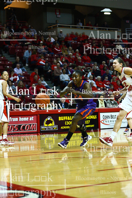 01 January 2012:  Taylor Lane moves towards the hoop as Alison Seberger approaches during an NCAA women's basketball game between the Evansville Purple Aces and the Illinois Sate Redbirds at Redbird Arena in Normal IL