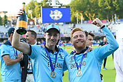 Chris Woakes of England and Jonny Bairstow of England celebrating on the lap of honour after winning the Cricket World Cup during the ICC Cricket World Cup 2019 Final match between New Zealand and England at Lord's Cricket Ground, St John's Wood, United Kingdom on 14 July 2019.