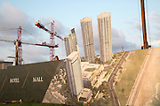 Construction site building activity image with cranes neat Twin Towers of World Trade Centre, Colombo, Sri Lanka, Asia