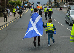 May 5, 2018 - Glasgow, Glasgow City, United Kingdom - A mother and her child ahead of the protest and wearing objects in support of the movement..Thousands of Scottish independence supporters marched through Glasgow as part of the 'all under one banner' protest, as the coalition aims to run such event until Scotland is 'freeâ (Credit Image: © Stewart Kirby/SOPA Images via ZUMA Wire)