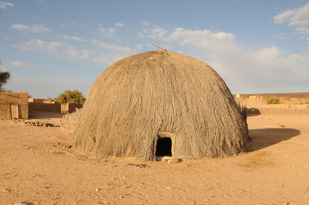 Traditional house made of straw on the countryside in the saharan desert, Western Africa, Mauretania, Africa