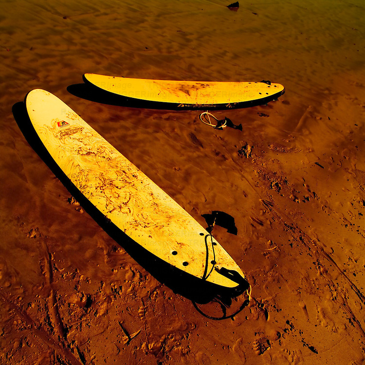 Two surf boards on a beach