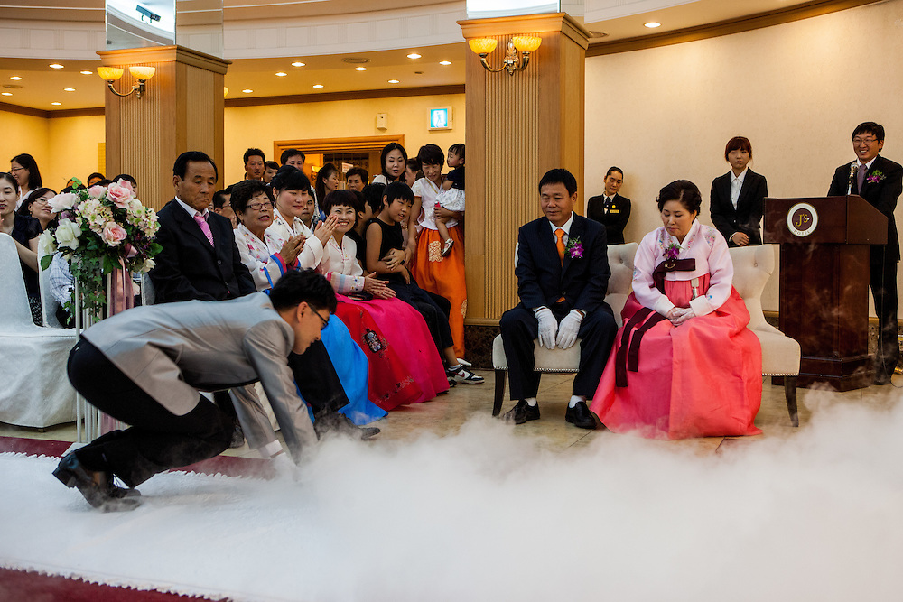 "A ""modern"" Korean wedding in the South Korean city of Daegu. The becoming husband is bowing for showing his respect to the parents of his new wife."