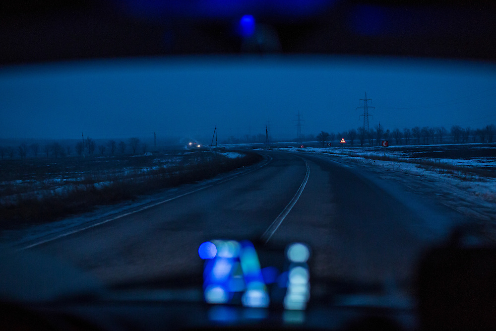 DONETSK, UKRAINE - JANUARY 22, 2015: The road at dusk between the last Ukrainian-controlled checkpoint and the first rebel-controlled checkpoint in Donetsk, Ukraine. The no-man's-land represents contested territory. CREDIT: Brendan Hoffman for The New York Times