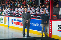 REGINA, SK - MAY 23: Sportsnet broadcaster Rob Faulds stands on the ice during the national anthem at the bench of the Regina Pats at the Brandt Centre on May 23, 2018 in Regina, Canada. (Photo by Marissa Baecker/CHL Images)