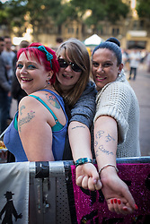 © Licensed to London News Pictures . 31/08/2013 . Rochdale , UK . Friends and manic The Feeling fans , show off their The Feeling tattoos - l-r Becci Snow (39 from Hull) , Natasha Ramsey (22 from Croydon) and Susan Harper (37 from Newcastle) . They all follow The Feeling all over the UK . The Feeling perform at a free gig in Rochdale. Photo credit : Joel Goodman/LNP