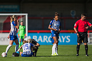 Kayleigh Green (Brighton) being treated by Lisa Walsh, Physiotherapist for Brighton & Hove Albion FC while Lee Collins (Referee) checks his watch during the FA Women's Super League match between Brighton and Hove Albion Women and Chelsea at The People's Pension Stadium, Crawley, England on 15 September 2019.