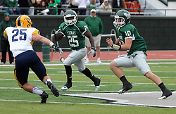 18 October 2014: Anfernee Roberts adds some blocking for Donovan Laible as Gran Burke looks to make a stop during an NCAA division 3 football game between the Augustana Vikings and the Illinois Wesleyan Titans in Tucci Stadium on Wilder Field, Bloomington IL