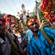 People celebrating in front of a truck transporting the idol of the Hindu goddess Durga to the site of the immersion during the Durga Puja festival some 40km from the capital New Delhi, September 2009