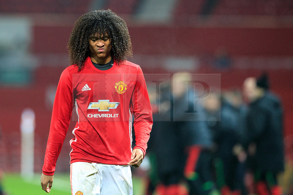 © Licensed to London News Pictures . 12/12/2016 . Manchester , UK . Dejected substitute TAHITH CHONG leaves the pitch at the end of the match . Manchester United vs Southampton FA Youth Cup Third Round match at Old Trafford . Photo credit : Joel Goodman/LNP