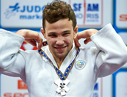 Warsaw, Poland - 2017 April 20: Adrian Gomboc from Slovenia holds his silver medal while awarding ceremony the men&iacute;s 66kg during European Judo Championships 2017 at Torwar Hall on April 20, 2017 in Warsaw, Poland.<br /> <br /> Mandatory credit:<br /> Photo by &copy; Adam Nurkiewicz / Mediasport / Sportida<br /> <br /> Adam Nurkiewicz declares that he has no rights to the image of people at the photographs of his authorship.<br /> <br /> Picture also available in RAW (NEF) or TIFF format on special request.<br /> <br /> Any editorial, commercial or promotional use requires written permission from the author of image.