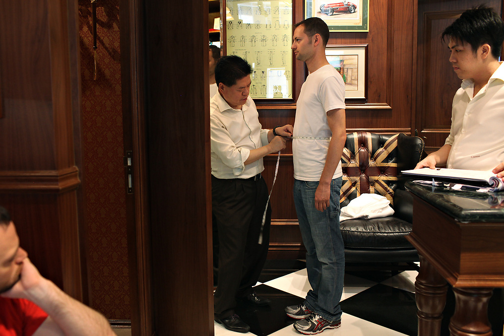 Harry Chen measures a client for a suit at Il Sarto, Hong Kong, China; September, 2013.