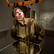 """Alexander Lavrentiev (Lavrentyev), grandson of renowed Russian constructivist artist Alexander Rodchenko, poses for portrait by the """"Three-Dimension Construction number 10"""" of the series """"Light Reflecting Planes"""" at Rodchenko's exhibition in Moscow. Picture by Justin Jin."""