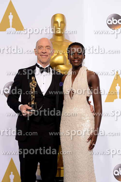 Actor J.K. Simmons (L) poses with Lupita?Nyong'o after winning the Best Actor in a Supporting Role award for &quot;Whiplash&quot; during the 87th Academy Awards at the Dolby Theater in Los Angeles, the United States, on Feb. 22, 2015. EXPA Pictures &copy; 2015, PhotoCredit: EXPA/ Photoshot/ Yang Lei<br /> <br /> *****ATTENTION - for AUT, SLO, CRO, SRB, BIH, MAZ only*****
