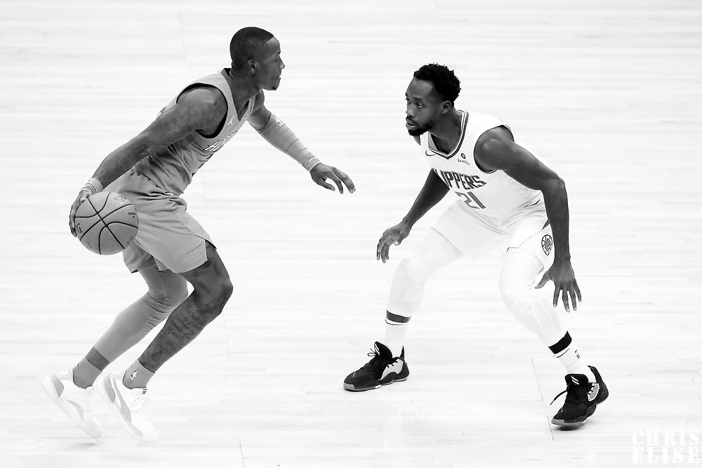 LOS ANGELES, CA - OCT 28: Patrick Beverley (21) of the LA Clippers defends on Devonte' Graham (4) of the Charlotte Hornets during a game on October 28, 2019 at the Staples Center, in Los Angeles, California.