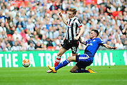 Grimsby Town midfielder Jon Nolan is brought down during the FA Trophy match between Grimsby Town FC and Halifax Town at Wembley Stadium, London, England on 22 May 2016. Photo by Mike Sheridan.