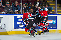 KELOWNA, CANADA - NOVEMBER 10: Tyler Benson #17 of the Vancouver Giants is checked into the boards by James Hilsendager #2 as Leif Mattson #28 of the Kelowna Rockets digs the puck away during first period on November 10, 2017 at Prospera Place in Kelowna, British Columbia, Canada.  (Photo by Marissa Baecker/Shoot the Breeze)  *** Local Caption ***