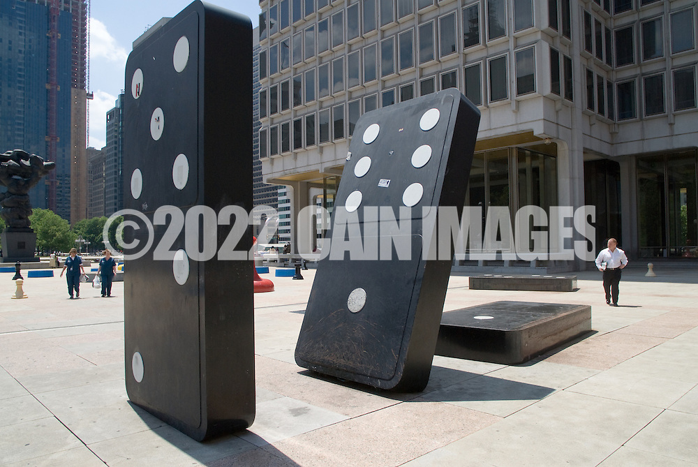 "PHILADELPHIA  - JUNE 24:  Pedestrians pass by ""Your Move"" by Roger White at the Municipal Services Building June 24, 2008 in Philadelphia, Pennsylvania. (Photo by William Thomas Cain)"