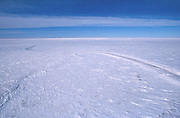 Alaska. North Slope, Arctic Ocean Sea ice road provides winter access for exploration and remote oil developments.